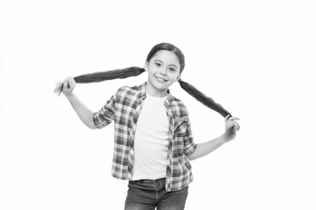 Healthy hair care habits. Kid happy smiling cheerful face with adorable hairstyle white background isolated. Strong hair concept. Kid girl long healthy shiny hair. Little girl grow long hair