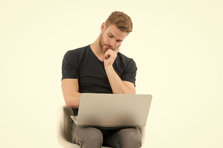 I should skip this. Man with laptop bored face watching advertisement. Guy handsome unshaven in black shirt works computer isolated white. Man bored of annoying advertisement videos.