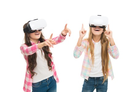 Play cyber game and study. Modern education. Alternative education technologies. Virtual education. Kids wear hmd explore virtual or augmented reality. Girls interact cyber reality. Game and fun.