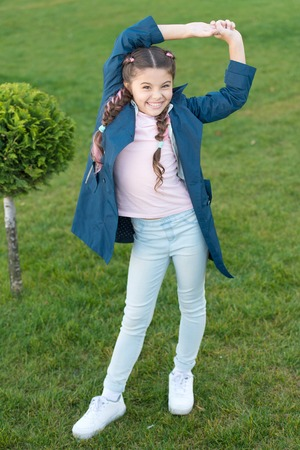 relax in park. Autumn weather. Happy child relax outdoor. nature relax. Spring fashion for little girl. Little girl with trendy hairstyle. Parks and outdoor. time to relax. what a great day. Zdjęcie Seryjne