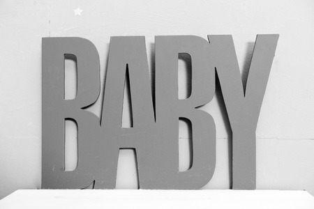 baby. Beautiful decorations for baby shower party. The inscription made of wood baby. childhood happiness. Newborn party celebration. Kids shop. Baby goods. Child.