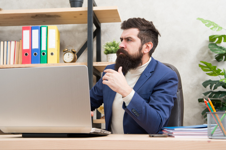 system administrator servicing server rack. configuration of computer systems and networks. Brutal man in business office. Mature man hipster use computer. Male boss working. sysadmin day 28 July.