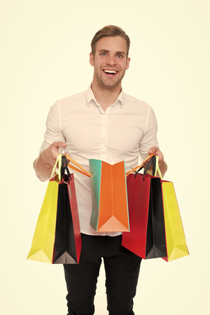 Shopping list. People overspend or buy things they not want, not need because they have not prepared properly. Guy happy shopped with list bought exactly what he needs. Man carry shopping bag.