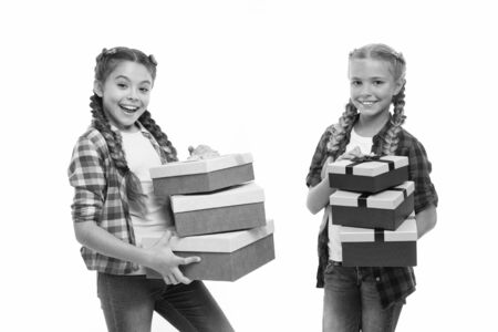 Kids little girls with braids hairstyle hold piles gift boxes. Children excited about unpacking gifts. Small girls sisters received birthday gifts. Dreams come true. Best birthday and christmas gifts.