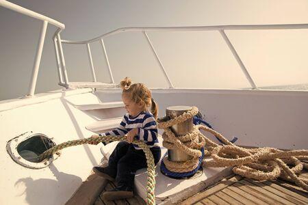 Journey concept. Little kid enjoy sea journey. Get ready for journey.