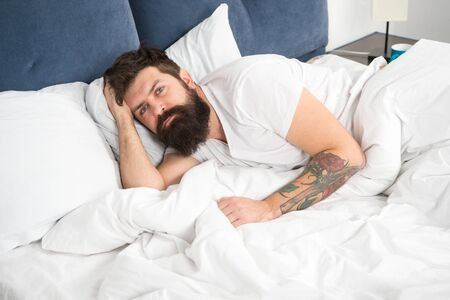Man bearded hipster having problems with sleep. Guy lying in bed try to relax and fall asleep. Relaxation techniques. Violations of sleep and wakefulness. Need some rest. Sleep disorders concept. Banque d'images - 132014333