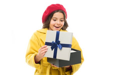 Astonished kid. Girl cute little lady coat and beret carry gift. Spring shopping concept. Buy clothes and cute little gifts for spring season. Satisfying shopping day. Child stylish hold gift box.