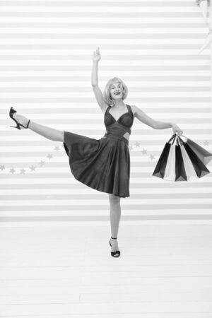 Shopaholic. Fashion. Black Friday sales. Last preparations. big sale in shopping mall. Crazy girl with shopping bags. happy woman go shopping. Happy shopping online. Woman dancing with packages.