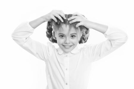 Girl long braids white background. Keep hair braided for tidy look. Kid pupil play with long braided hair. Hairdresser salon. Hairstyles which suits to formal school style. Appropriate hairstyle. Stok Fotoğraf