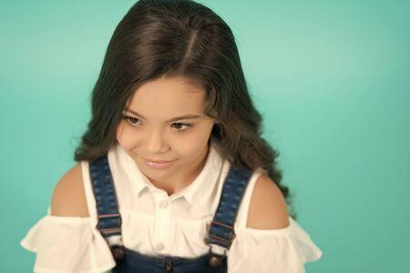 Hairstyle kid model on blue background. Hairstyle, hair style, hairstyling, style, hairdressing, beauty salon concept Stok Fotoğraf