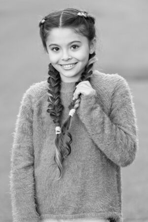 small girl child with perfect hair. Happy little girl. Beauty and fashion. small kid fashion. Childhood happiness. International childrens day. Developing new fashion line. Young expertise. Stock Photo
