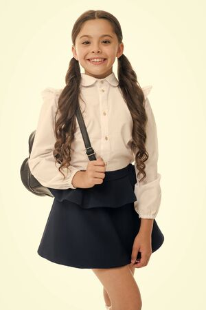Learn how fit backpack correctly for school. Schoolgirl cute in formal uniform wear backpack. School backpack concept. Follow these tips. Right and wrong ways to wear backpack to prevent pain.