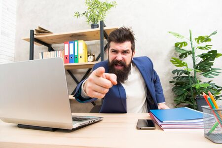 Angry boss. feeling so angry. Angry businessman. Furious mature man pointing finger on you. Blaming each other. Brutal businessman in office. Mature bearded hipster use computer. Male boss working.