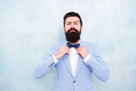 Man bearded hipster formal suit with bow tie. Wedding fashion. Formal style perfect outfit. Impeccable groom. Tips for dealing pre wedding anxiety. Tips for grooms. How to beat nerves on wedding day. Stock Photo