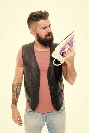Hipster looking at electric ironing tool.