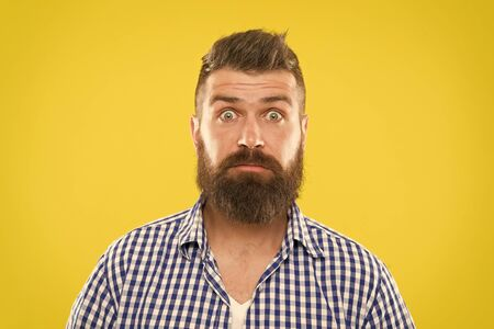 Surprising news. Man bearded hipster wondering face yellow