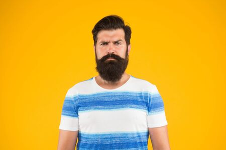 Man bearded hipster with mustache and long beard on yellow
