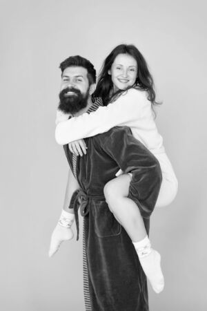 Bearded man and woman in robe.