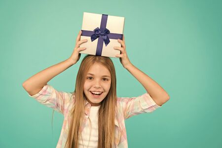 Girl kid hold birthday gift box. Every kid dream about such surprise. Birthday girl carry present. Making gifts. Birthday wish list. Happiness and joy. Happy birthday concept. Pleasant surprise. Stockfoto - 127194387