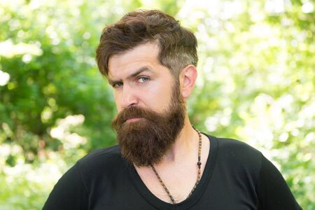 This is what man wants to look like. Bearded man in casual style on natural landscape. Caucasian man with long mustache and beard hair outdoor. Brutal man with unshaven face and stylish haircut. Stock fotó