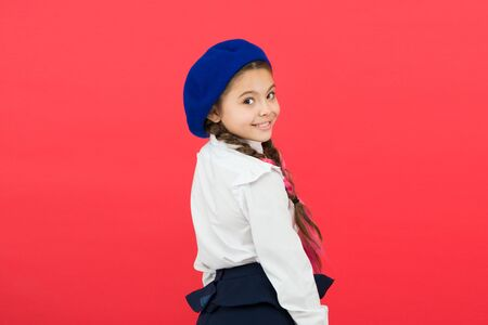 Schoolgirl wear formal school uniform and beret hat.