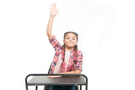 September 1 the first day of school year. Little girl raising hand on September 1 isolated on white. Small pupil having lesson on September 1. Adorable schoolchild at first day of school. September 1