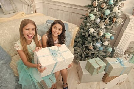 Happy new year. Winter. Christmas tree and presents. xmas online shopping. Family holiday. The morning before Xmas. Little girls. Child enjoy the holiday. Its yours