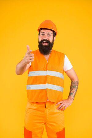 Man engineer protective uniform orange background. Engineering career concept. Architect builder engineer. Good job. Safety apparel for construction industry. Bearded brutal hipster safety engineer