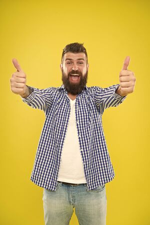 Good job. Beard fashion and barber concept. Man bearded hipster stylish beard yellow background. Barber tips maintain beard. Stylish beard and mustache care. Hipster appearance. Emotional expression