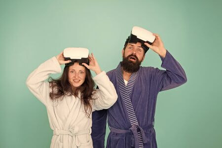 Happy family in vr glasses. Good morning. Virtual reality. Love. Couple in love. Family. Bearded man and woman in robe pajama. it it so real. future is now. bearded man hipster with happy girl