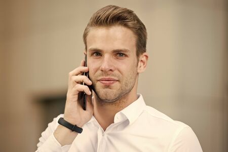 Ask information. Businessman calling client hold smartphone urban background defocused. Man manager phone conversation. Guy with smartphone call friend. Mobile call concept. Successful business call
