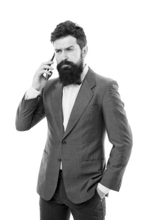 Young perfectionist. man speak on phone. business communication. Agile business. mature man. success deal. Business talk. bearded businessman in suit. Always available. Talking business details