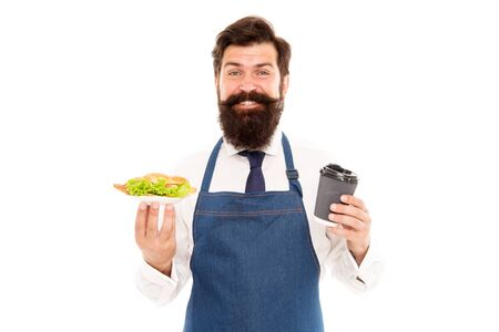 Enjoy your meal. Guy serving croissant stuffed lettuce and fresh vegetables. Healthy food. Delicious croissant. Man bearded waiter wear apron carry plate with food and coffee cup. Cafe food concept Archivio Fotografico
