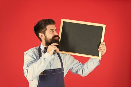 Happy hours bar. Hipster bartender show blackboard copy space. Hipster restaurant staff. Hipster informing you. Man bearded bartender or cook in apron hold blank chalkboard. Price list concept