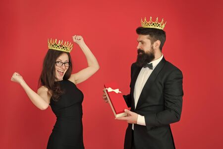 reward. man in tuxedo and sexy woman. Bearded man and happy woman in crown. royal couple in love. date success. fashion look. anniversary party gift. Formal couple. pleasant reward. For you