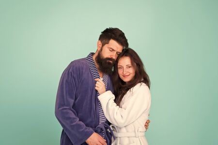 Sleepy man embrace his girl. Bearded man and woman in robe pajama. Couple in love. sleepy family. Wake up morning. Love and romance. Happy family in morning. couple looks sleepy in morning. Insomnia