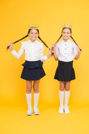 Brilliant pupils. Schoolgirls wear golden crowns symbol of respect. Award and respect. Cute princess. Motivational award for school children. Girls kids imaging luxury lifestyle. Award coronation