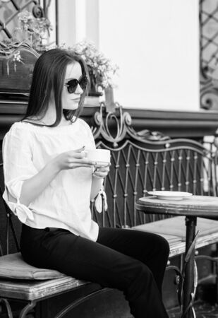 summer fashion beauty. Meeting in cafe. girl relax in cafe. Business lunch. stylish woman in glasses drink coffee. good morning. Breakfast time. morning coffee. Waiting for date. More coffee