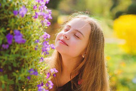 Enjoying nature. Kid cute fancy child spend time in park. Explore garden. Excursion to botanical garden. Spring bloom fragrance. Girl teen walk in botanical garden. Peaceful environment garden