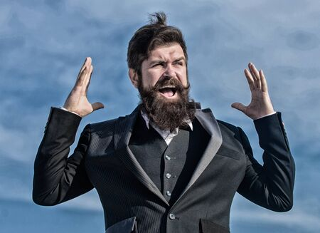 Businessman against the sky. Bearded man touch beard. Man with beard outdoor. brutal caucasian hipster with moustache. Bearded man. Future success. Male formal fashion. Mature hipster with beard