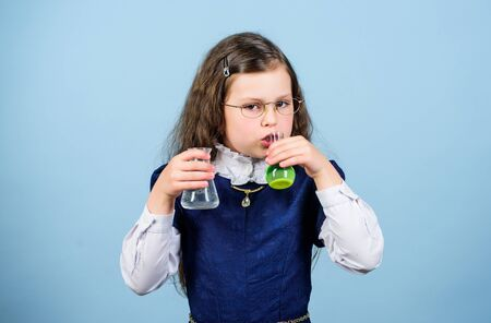 Time to chill. science research in lab. Small genius girl. small girl scientist with testing flask. child study bilogy lesson. Discover future. education and knowledge. back to school Stockfoto