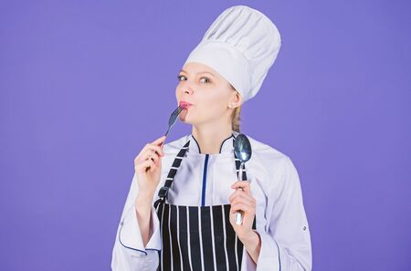 She is hungry. Enjoy your meal. Woman chef hold utensil spoon fork. Appetite and taste. Traditional culinary meal. Professional cook and cooking at home. Tasty homemade food. Time to try meal