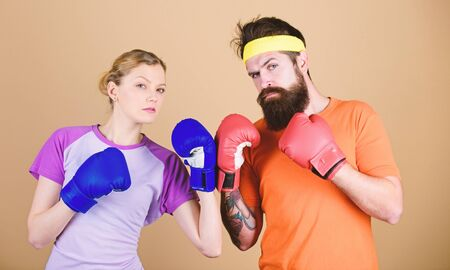 One spirit, one team, one win. punching, sport Success. sportswear. Fight. training with coach. Happy woman and bearded man workout in gym. knockout and energy. couple training in boxing gloves
