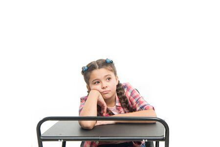 Boring lesson. Girl bored pupil sit at desk. Issues of formal education. Back to school concept. Kid cute tired of boring studying. Boring educational program. Need some rest and entertainment Banque d'images