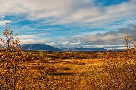iceland plain landscape view with field in reykjavik. autumn landscape of plain thingvellir. weather and climate. nature and ecology. nature places to stop. sense of freedom. iceland mountains.