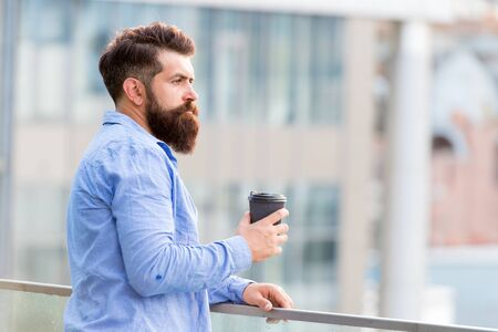 Morning inspiration. thoughtful man drink take away coffee. morning coffee. Mature hipster with beard. Bearded man relax. brutal hipster with coffee cup. energy charge. Male barber care. copy space
