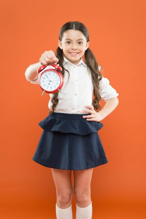 start lesson. time to go to school. School time. Happy girl hold alarm clock counting for lunch time. Children education. Knowledge day. daily routine schedule. schoolgirl and retro alarm clock Stockfoto - 128884195
