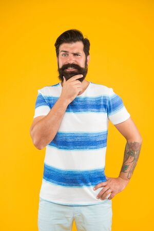Cheerful sailor. Join my wave. Guy dressed striped shirt on summer vacation. Barbershop concept. Man bearded hipster with mustache and long beard on yellow background. Summer vacation. Summer style