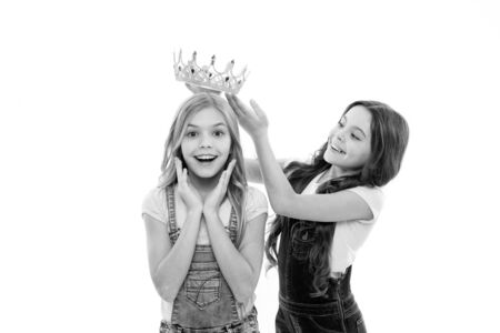Rich reward. Little girl putting crown on head of small beauty queen winner as reward. Adorable mini miss beauty pageant winner taking reward for success. Awarding with prize and reward