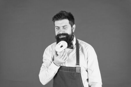 Chef man in cafe. Food calorie. Bearded man in apron. Donut food. Diet and healthy food. baker hold donut. Funny hipster. Sweet food. Calorie. Feel hunger. Snack for business productivity